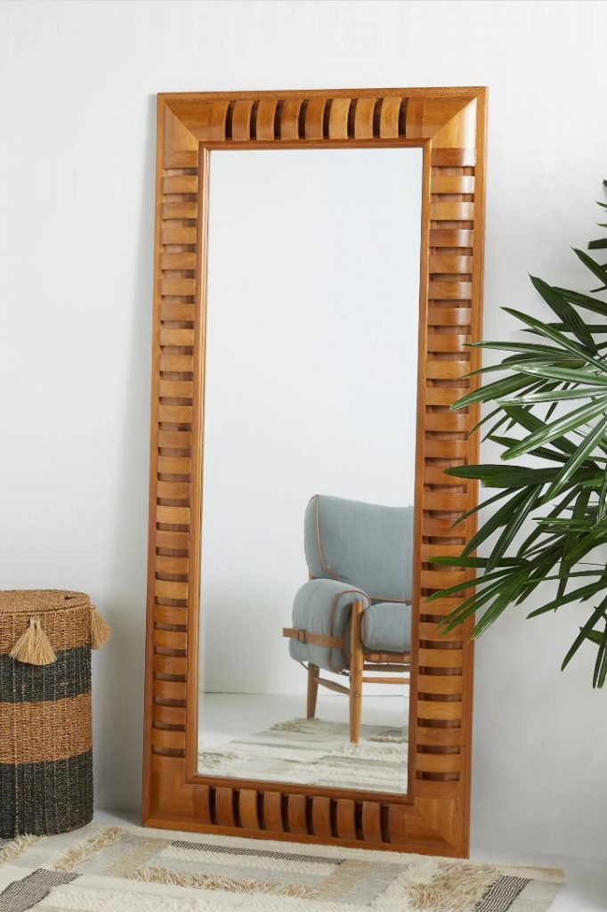 A large wood-framed mirror from Anthropologie