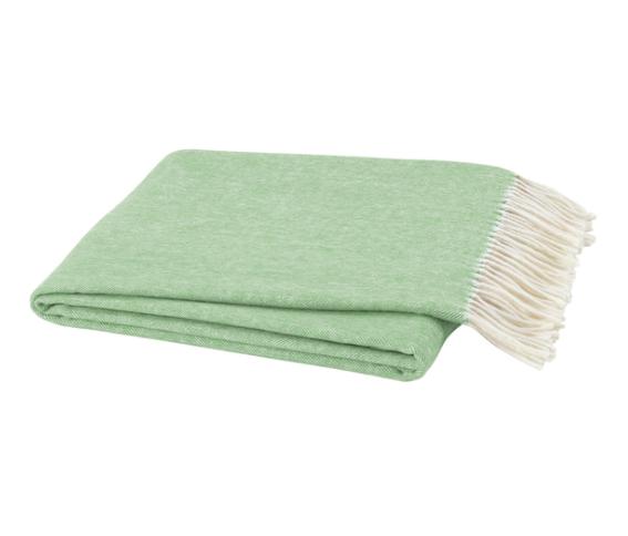 A green herringbone throw blanket from The Blue House Bethesda