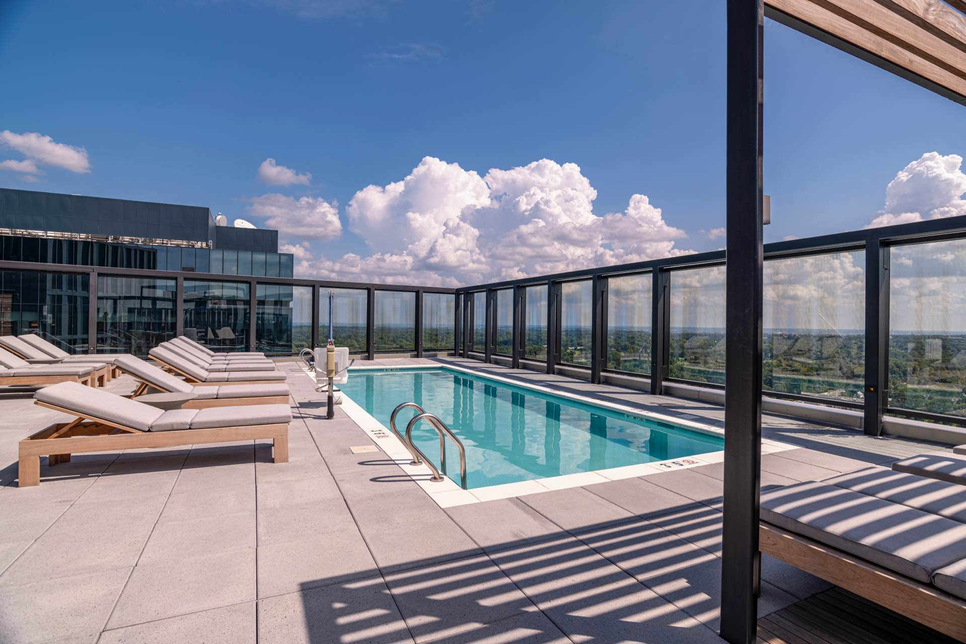 Welcome to a world of well-being and connection, featuring The Elm's rooftop heated pool and resort-style seating.
