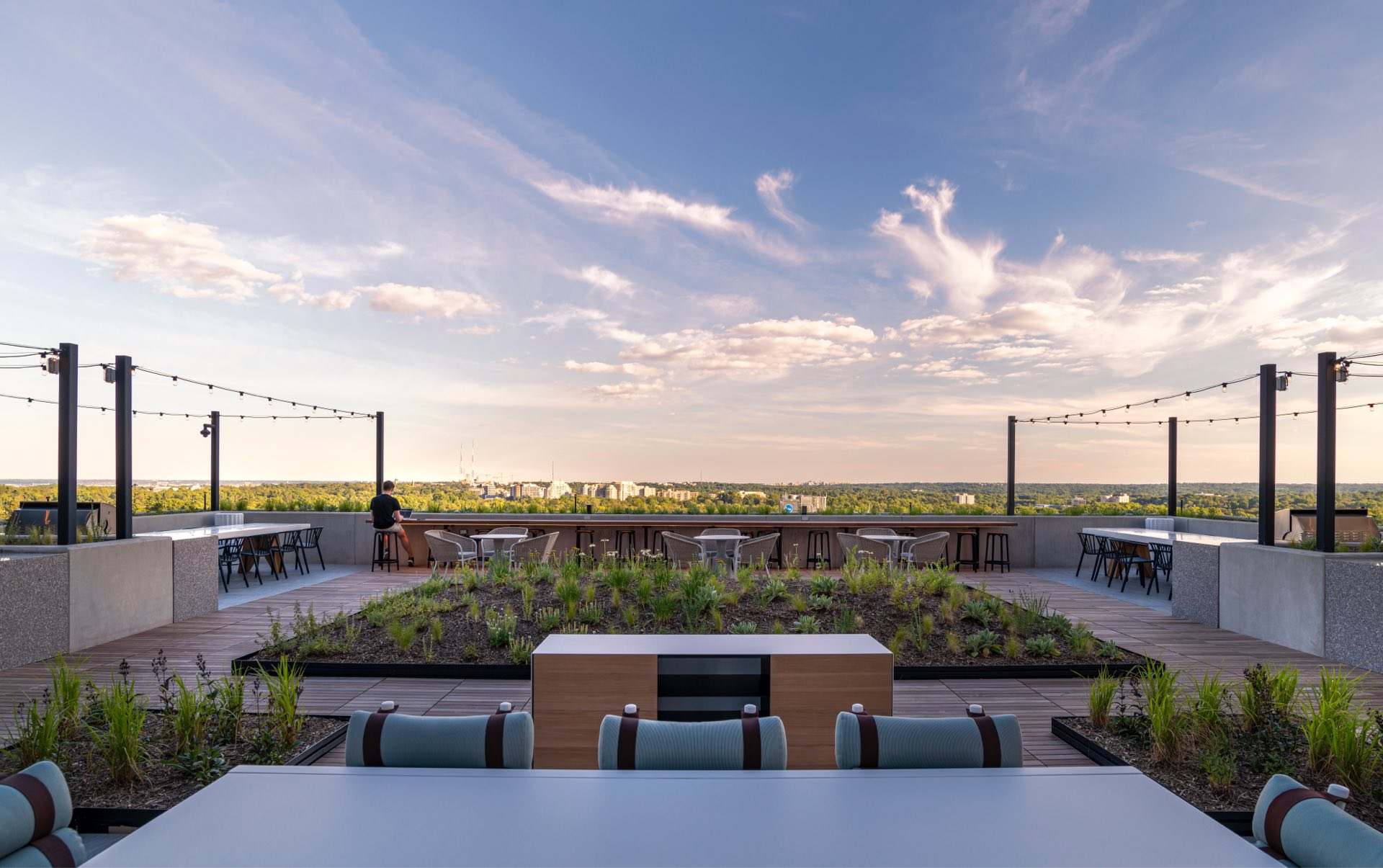 Surrounded by lushly landscaped green space, lounge seating, and grilling stations.