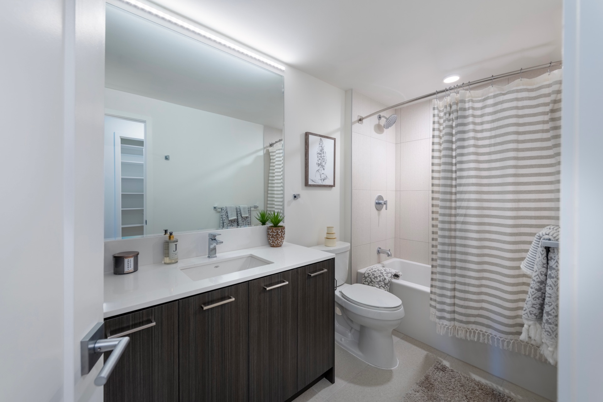 Backlit mirrors and walk-in showers or soaking tubs, perfect for your bathroom retreat.