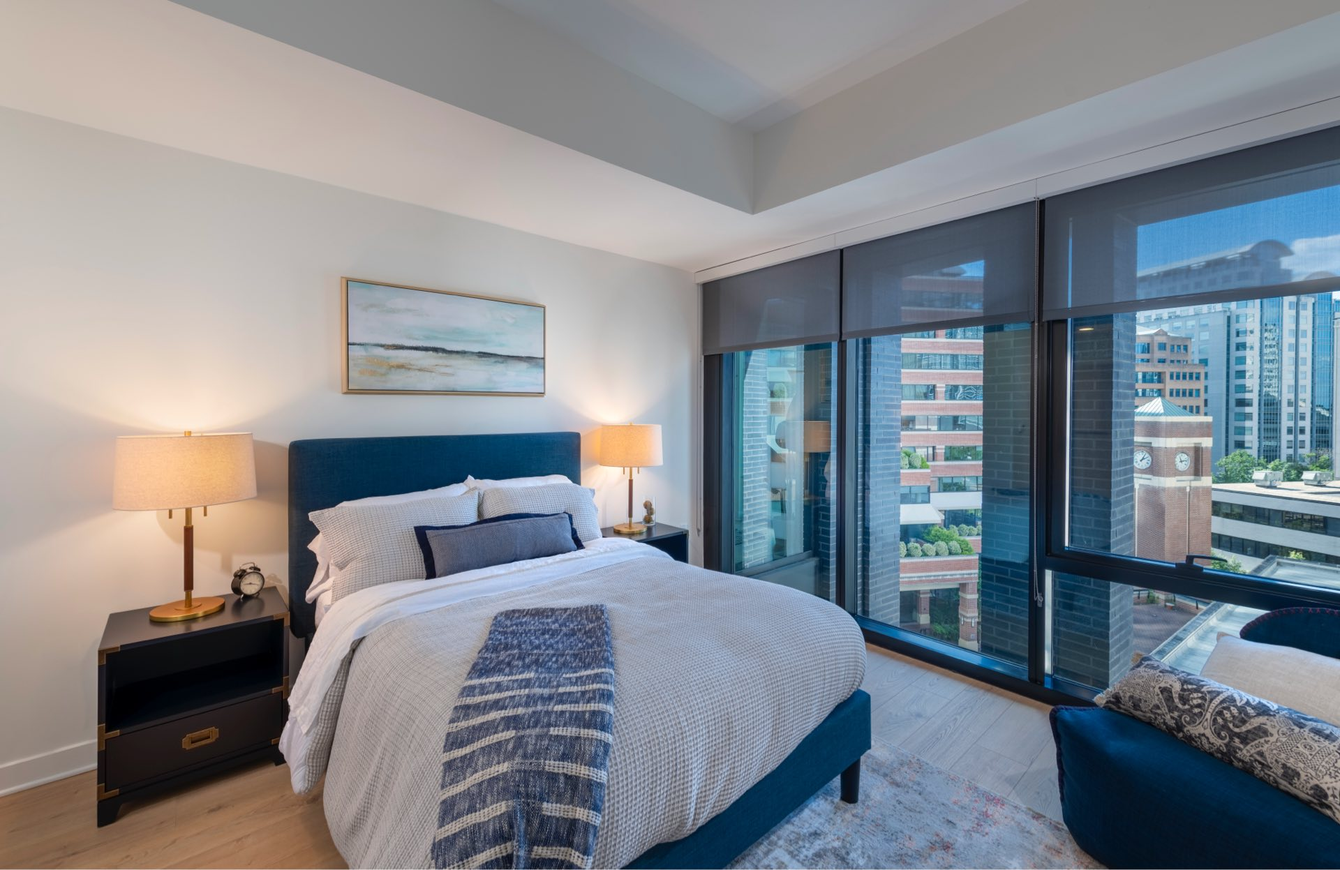 Spacious bedrooms with recessed, dimmable lighting, and roller shades.