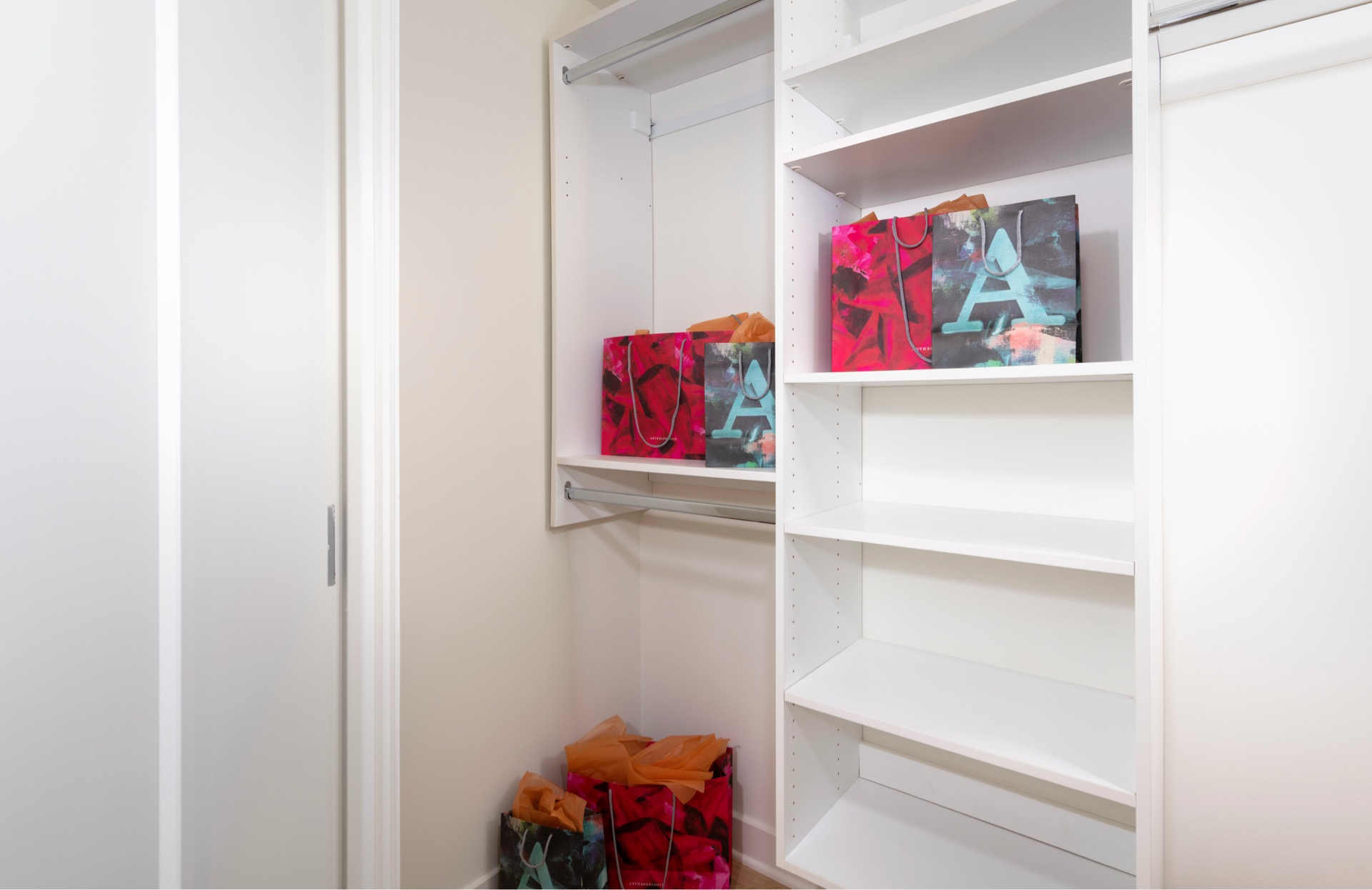 Built in closet shelving aids in the organizational charm and conveniences of your walk-in closet.*