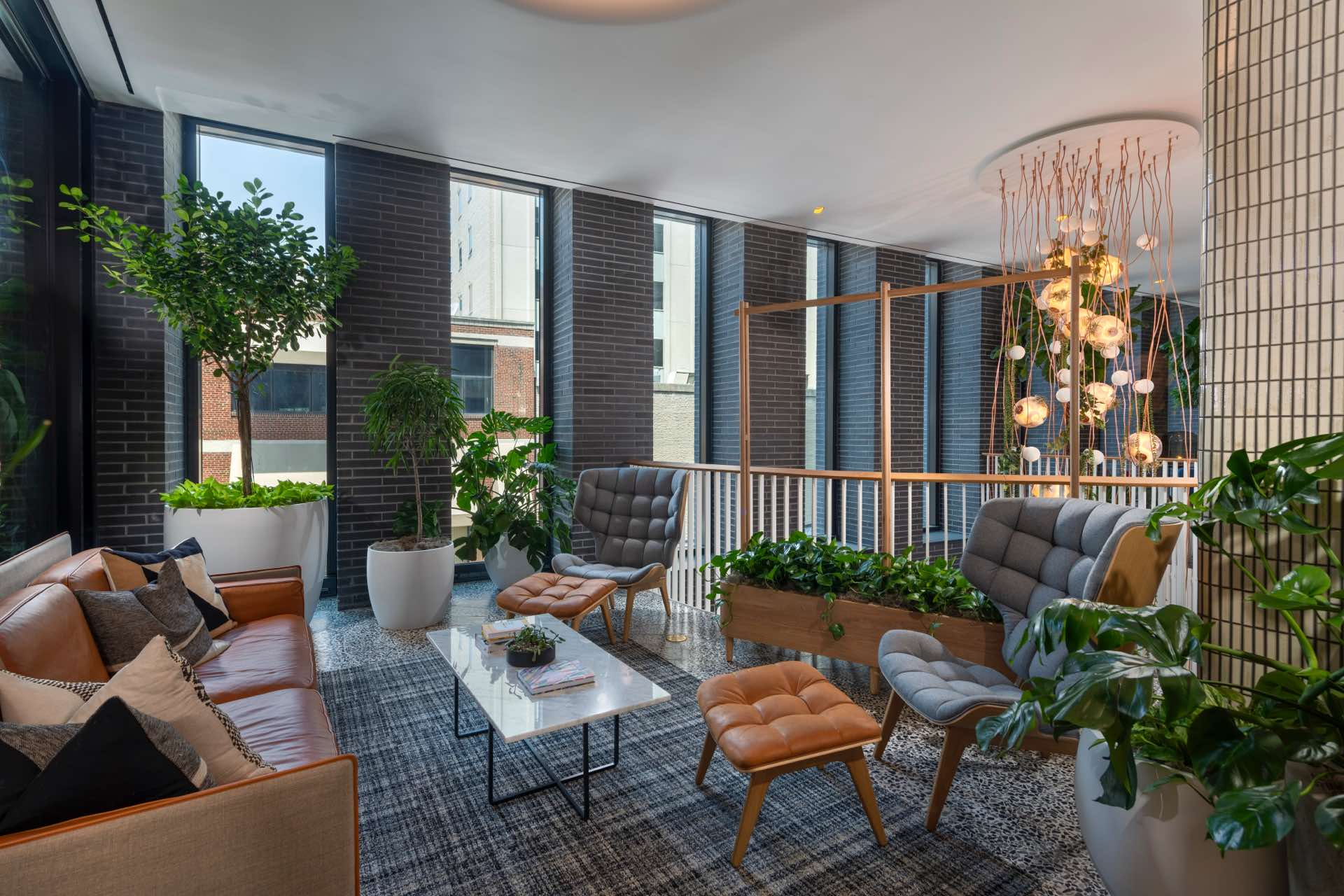 The lobby, detailed with a vibrant collection of communal lounge spaces.